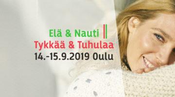 Elä & Nauti | Tykkää ja Tuhulaa yhteistyö logo jossa hymyilevä nainen villapaidassa taustalla