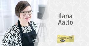 Hymyilevä Ilana Aalto pilkukas valkoinen paita ja musta esiliina päällään sekä Rakentaja 2019 Oulu -logo